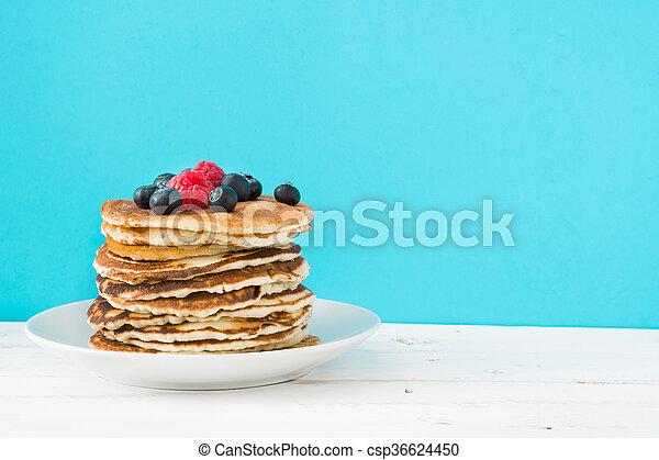 American pancakes with raspberries - csp36624450