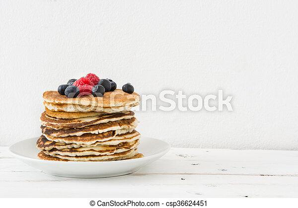 American pancakes with raspberries - csp36624451