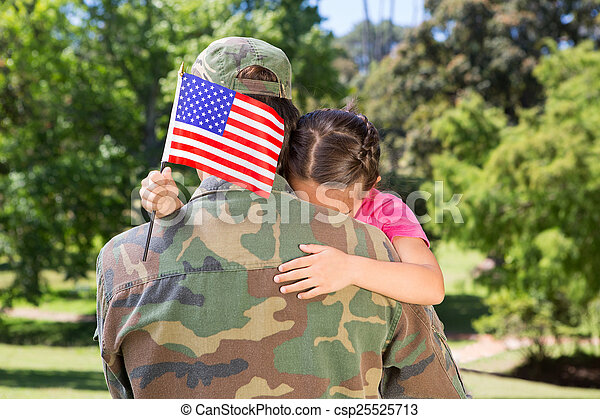 American soldier reunited with daughter - csp25525713