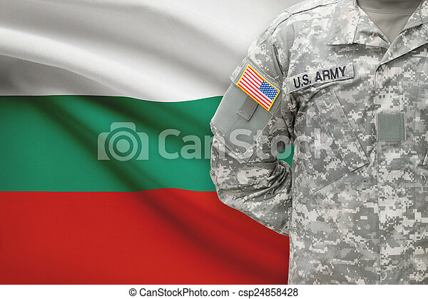 American soldier with flag on background - Bulgaria - csp24858428