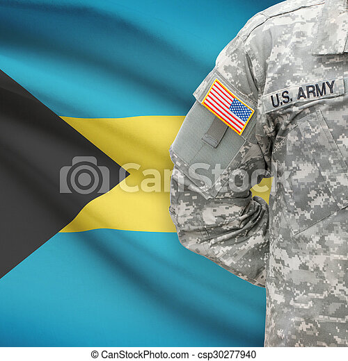 American soldier with flag on background - Bahamas - csp30277940