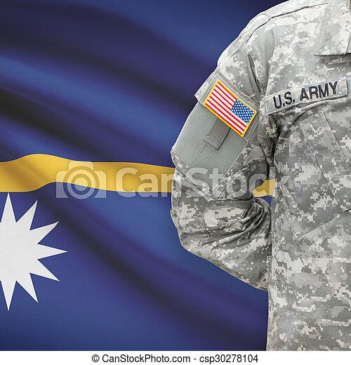 American soldier with flag on background - Nauru - csp30278104