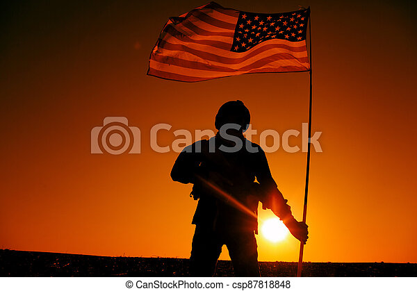American soldiers with national flag silhouette - csp87818848