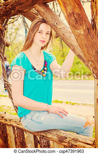 American Teenage Girl relaxing at Central Park in New York in spring day - csp47391963