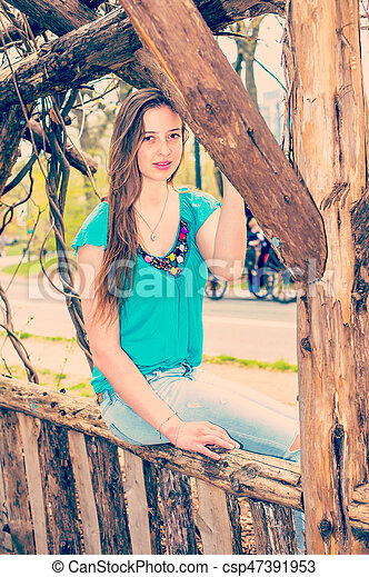 American Teenage Girl relaxing at Central Park in New York in spring day - csp47391953