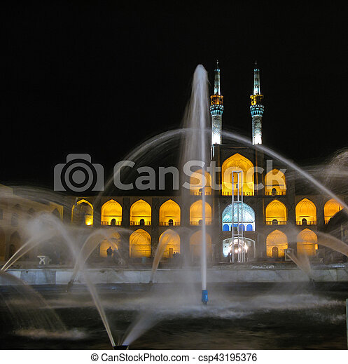Amir Chakhmaq Complex square and fountain at night, Yazd Iran - csp43195376