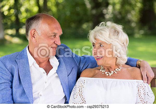 Amorous senior couple in park - csp29375213
