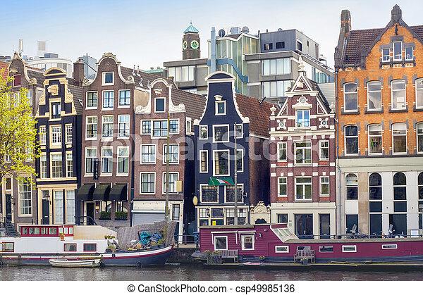 Amsterdam colourful buildings. - csp49985136