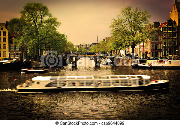 Amsterdam. Romantic bridge over canal. - csp9644099