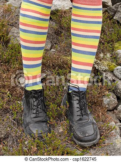 Amusing striped feet in boots - csp1622745