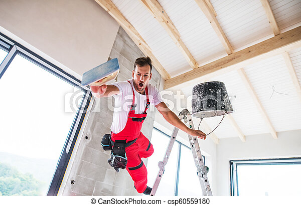 An accident of a man worker at the construction site. - csp60559180
