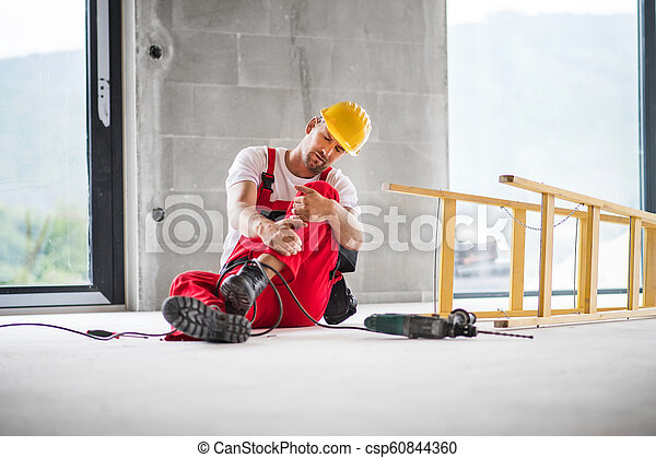 An accident of a man worker at the construction site. - csp60844360