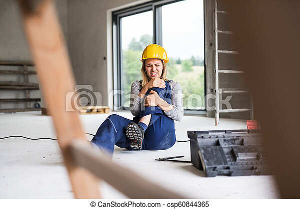An accident of a woman worker at the construction site. - csp60844365