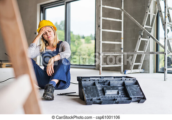 An accident of a woman worker at the construction site. - csp61001106