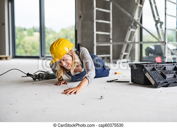 An accident of a woman worker at the construction site. - csp60375530