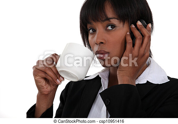 An African American businesswoman over the phone. - csp10951416
