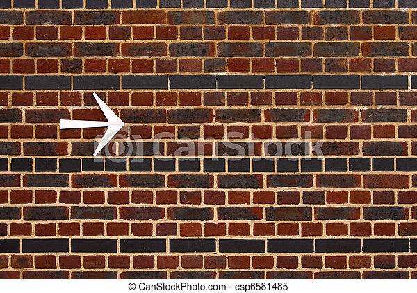 An arrow on a brick wall - csp6581485
