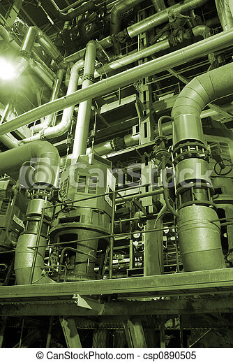 an assortment of different size and shaped pipes at a power plant.       - csp0890505