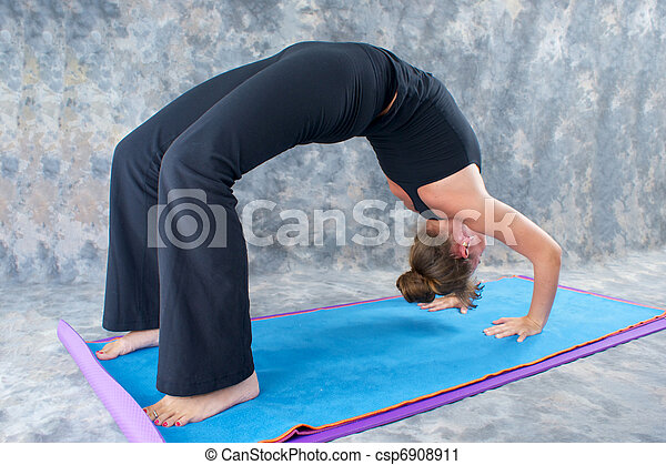an athletic brown haired woman is doing yoga exercise full