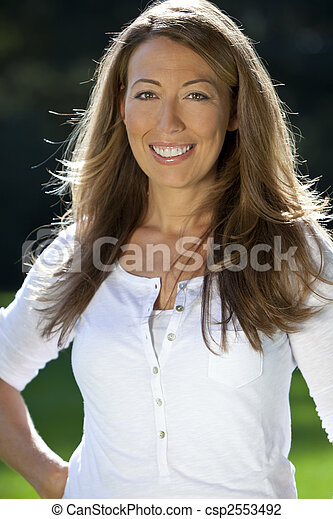 An Attractive Happy Woman In Her Thirties  - csp2553492