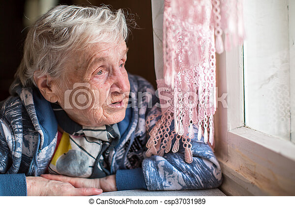 An elderly woman near the window. - csp37031989