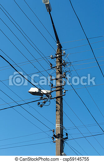 an electric post in with lots of wires - csp59145755
