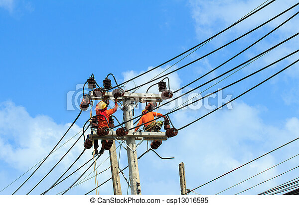 An electrical power utility worker fixes the power line. - csp13016595