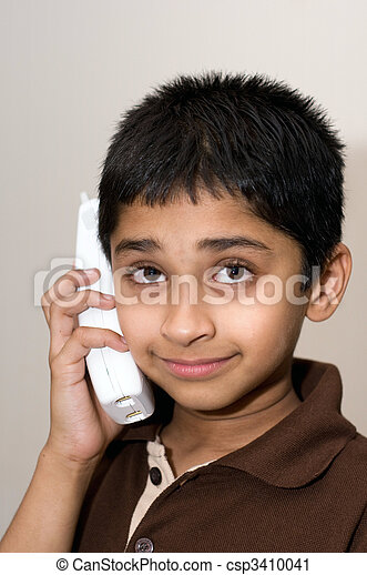 An handsome Indian kid talking on the phone - csp3410041