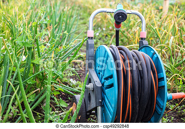 An image of a garden hose. Hose for irrigation - csp49292848