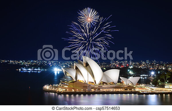 An impressive display of fireworks light up the sky in blue and white over Sydney, Australia - csp57514653
