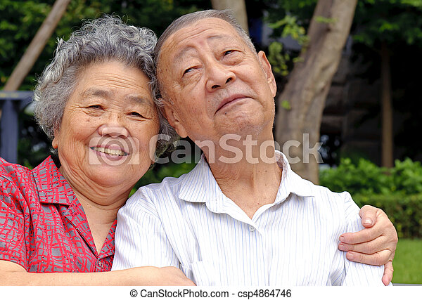 an intimate senior couple embraced - csp4864746