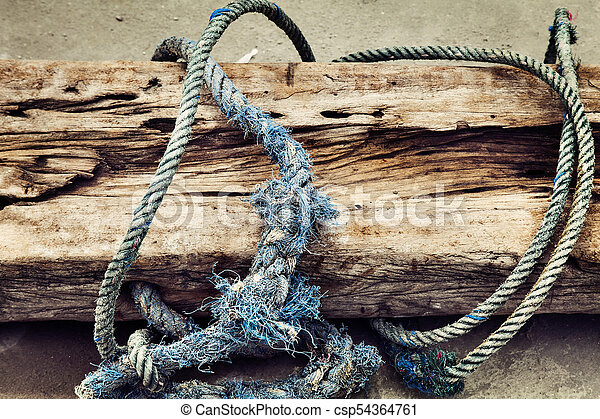 an old Boat Rope Textured on wooden background - csp54364761
