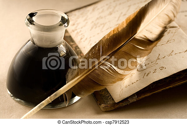 An old book with a feather and the inkpot full of ink - csp7912523