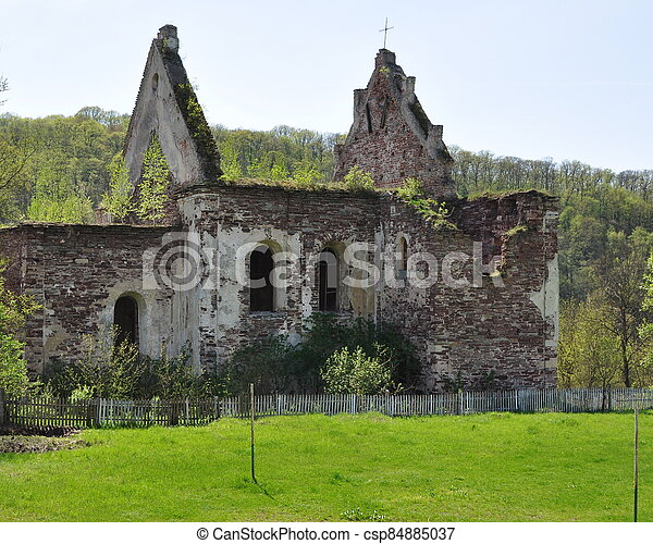 An old destroyed brick building with broken arched windows. - csp84885037