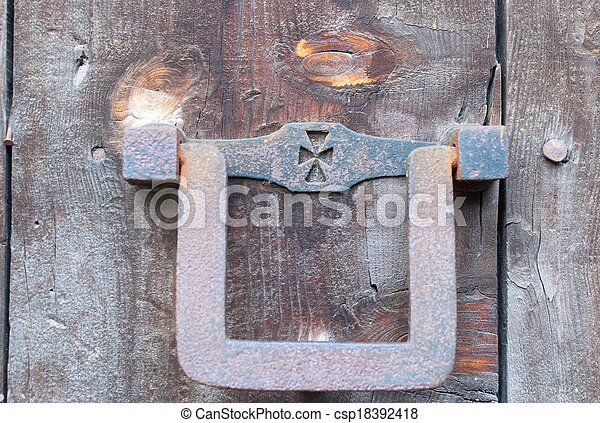 an old metal door handle knocker - csp18392418
