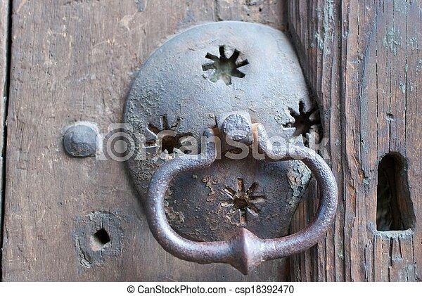 an old metal door handle knocker - csp18392470