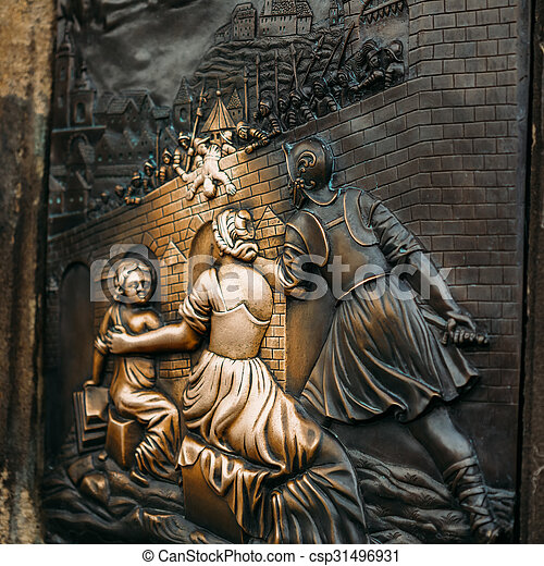An old relief below the statue of St. John of Nepomuk on Charles - csp31496931