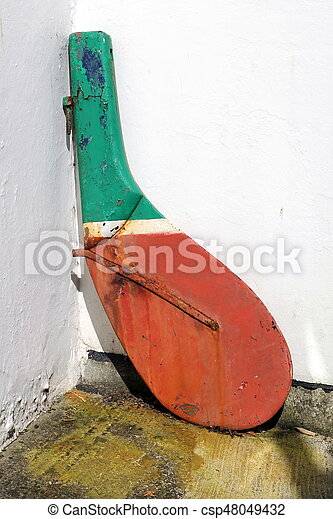 An old rudder from a fishing boat or rawler, being used as a decorative item in a back yard - csp48049432
