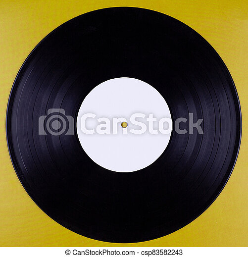 An old vinyl record with an empty label isolated against a mustard-colored background - csp83582243