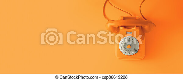 An orange vintage dial telephone. - csp86613228