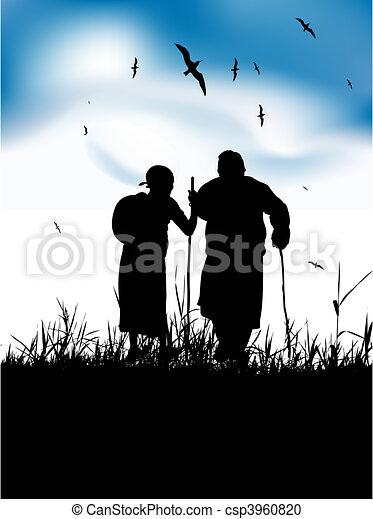 Dos ancianos caminan juntos sobre la naturaleza - csp3960820