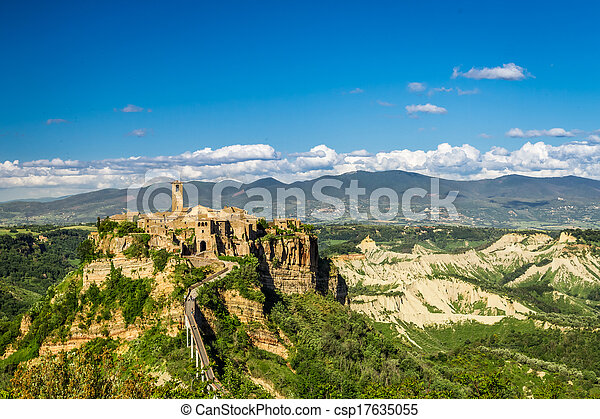 Ancient city on hill in Tuscany on a mountains background. - csp17635055