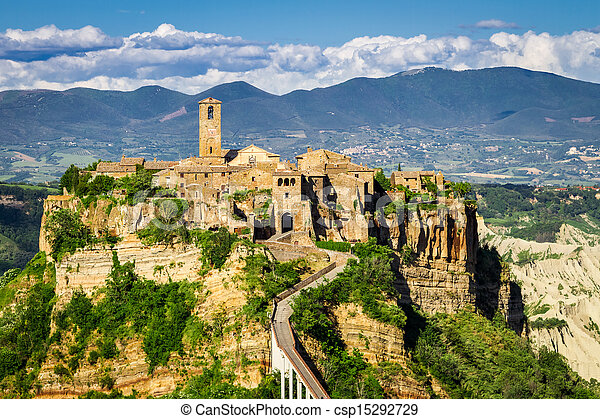 Ancient city on hill in Tuscany on a mountains background. - csp15292729