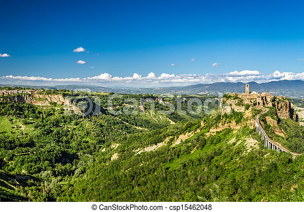 Ancient city on hill in Tuscany on a mountains background - csp15462048