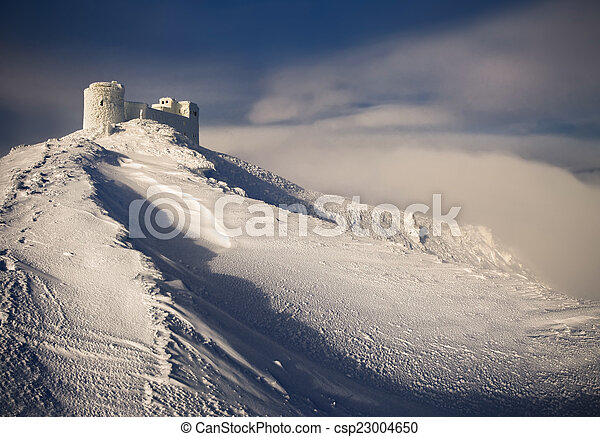 Ancient fortress in the; mountains in the winter - csp23004650