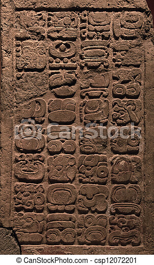 Stock Photography of Ancient Mayan hieroglyphs carved on a stone
