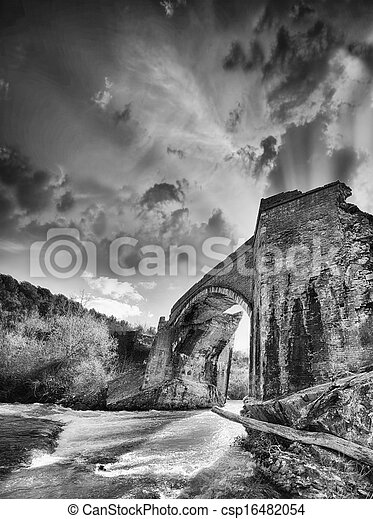 Ancient Medieval Bridge over a creek in Tuscany - csp16482054