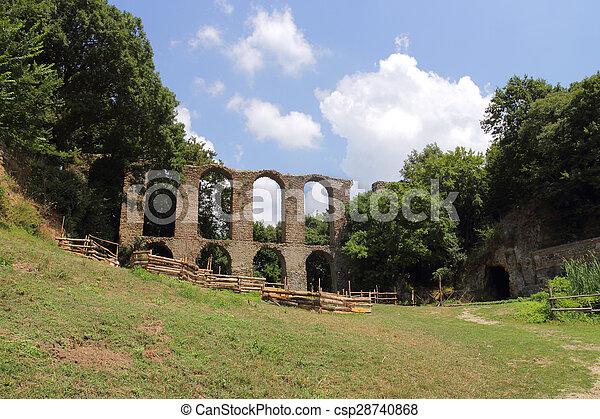 ancient Roman aqueduct in Monterano - csp28740868