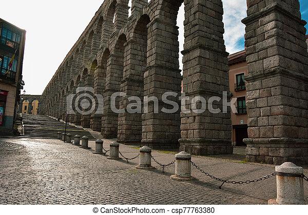 Ancient Roman Aqueduct in Segovia Spain - csp77763380