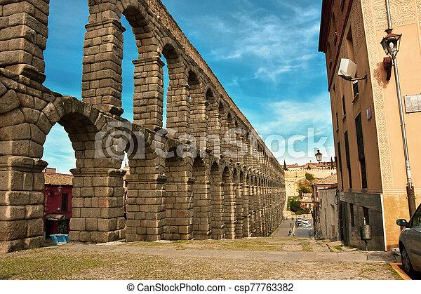 Ancient Roman Aqueduct in Segovia Spain - csp77763382